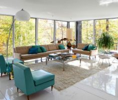 accent chairs for living room with green blue chair and brown long sofa in glass wall living room