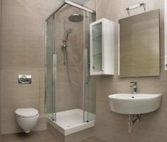 bathroom for small space with glass shower wall