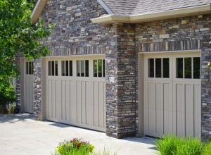 beauty-lowes-garage-doors-with-brick-wall-home