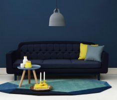blue living room wall decor with black tufted sofa