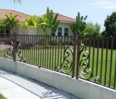 bronze metal fence design with elegant carv