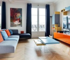 cheerful living room with grey blue and orange accent chairs for living room