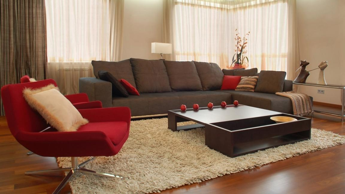 cozy living room with dark grey arm sofa and red modern