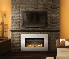 fancy propane fireplaces under tv set with bricks wall