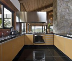 modern clean u shaped kitchen with black tiles