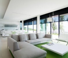 modern interior design with glass wall and white narrow coffee table