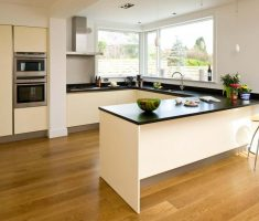 modern minimalist u shaped kitchen with black and white colours