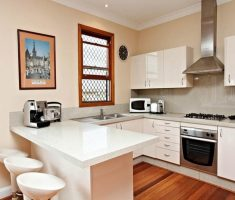narrow white u shaped kitchen for small space design