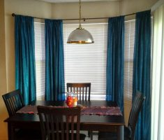 rustic dining room with blue curtain window treatments for bay windows suit