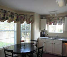 small kitchen with window treatments for bay windows suit