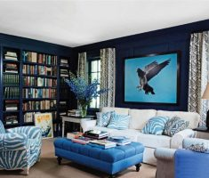 solid living room with blue living room table chair and picture walls