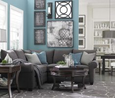 turquoise blue living room l shaped decor with black sofa and blue wall