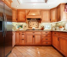 u shaped kitchen layut with wooden material cabinets