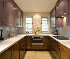 u shaped kitchen with purple cabinets for small space