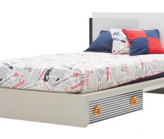unique small double bed for small bedroom with newspaper bed linen and drawer