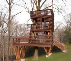 unique tree house design with wooden materials