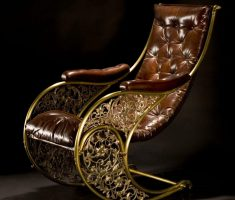 antique leather high back chair with tufted and gold metal materials