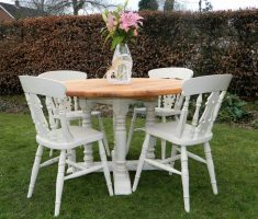 appealing rustic round farmhouse dining table and white chairs