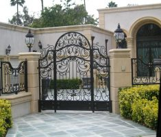 artistic metal fence with pillar wall for modern front gate designs