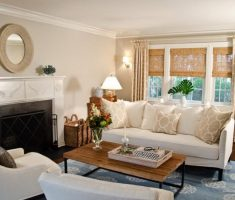 beige living room theme with modern window treatments
