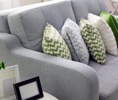 comfy grey sofa with green throw pillow covers design theme