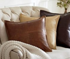 comfy tufted sofa with brown throw pillow leather covers design
