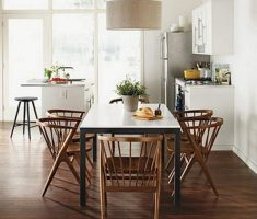 cozy modern wooden farmhouse dining table with round chandelier