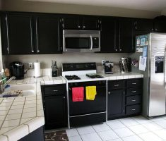 cute black modern small kitchen with white tiles