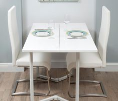cute small white dining table and chairs