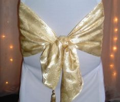 elegant spandex white folding chair covers and golden ribbons