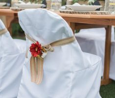 elegant white bridal folding chair covers with flower ribbon