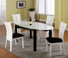 elegant white dining table and with black seating chairs