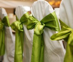 enchanting bridal white folding chair covers and green lime ribbons