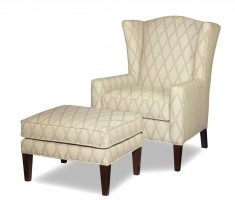 ivory high back chair with ottoman and diagonal strippes