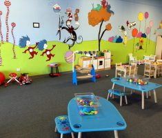kids indoor playground with cartoon character wall