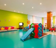 kids indoor playground with sliding and blue and green color themed