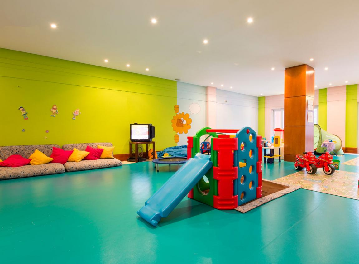 kids-indoor-playground-with-sliding-and-blue-and-green-color-themed