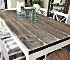 light and dark farmhouse dining table with chairs