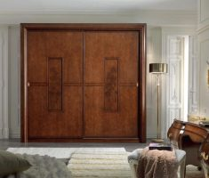 luxurious wooden sliding closet doors with carving