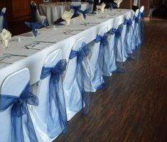 minimalist beautiful white folding chair covers with blue ribbons for wedding bridal