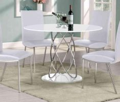 minimalist round white dining table and 4 chic chairs
