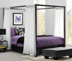 modern canopy beds with purple bed and white curtain on black wood pillars