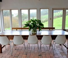 modern farmhouse dining table and modern white chairs