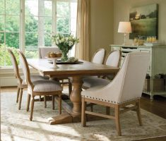 modern farmhouse dining table with ivory chiairs theme