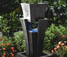 modern garden pots with fountain water