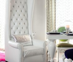 modern tufted white high back chair with silver cover pillow