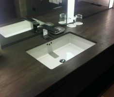 modern white undermount bathroom sinks with dark island
