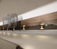 modern wooden wall mount shelf design with glass and wood materials with light under it