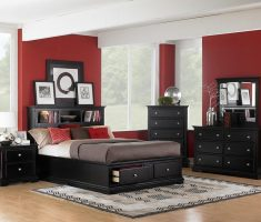 neat black rustic bedroom furniture with red wall decor