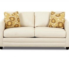 neat ivory small sofa bed sleeper with floral pillows